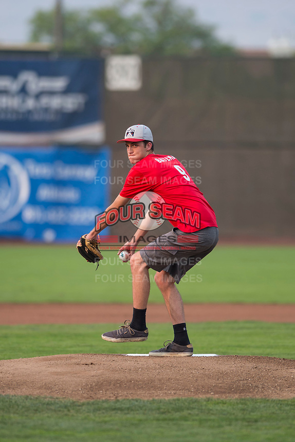 A fan throws out a first pitch before a Pioneer League game between the Ogden Raptors and the Great Falls Voyagers at Lindquist Field on August 23, 2018 in Ogden, Utah. The Ogden Raptors defeated the Great Falls Voyagers by a score of 8-7. (Zachary Lucy/Four Seam Images)