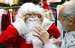 WATERBURY CT. 22 December 2017-122217SV04-Mike Patrick, Republican American, sees what it feels like to transform into Santa at Arabesque on Bank Street in Waterbury Friday. Michael Rinaldi, owner dressed Mike.<br /> Steven Valenti Republican-American