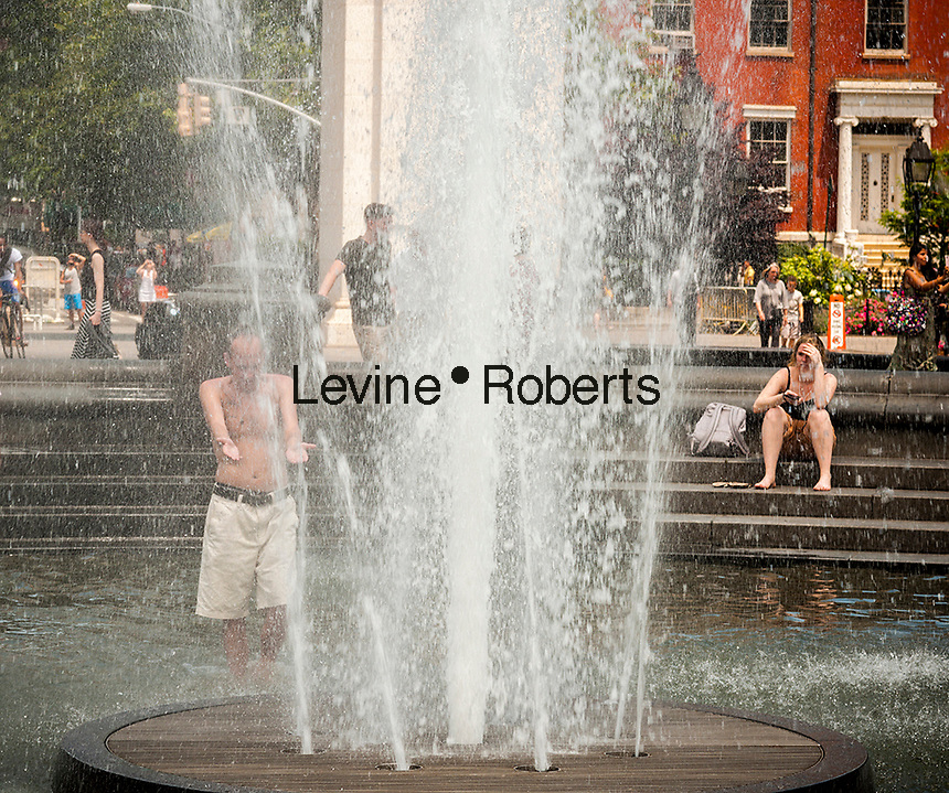 New Yorkers and visitors escape the heat in the fountain in Washington Square Park in Greenwich Village in New York on Tuesday, June 13, 2017. Temperatures have breached the 90 degree mark in the city for three days in a row making it officially a heat wave. ( © Richard B. Levine)