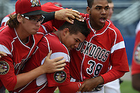Batavia Muckdogs catcher Rodrigo Vigil (27) is mobbed by teammates including Hayden Fox (55) and Wildert Pujols (38) after hitting a walk off two run home run in the bottom of the ninth inning during a game against the Williamsport Crosscutters on July 27, 2014 at Dwyer Stadium in Batavia, New York.  Batavia defeated Williamsport 6-5.  (Mike Janes/Four Seam Images)