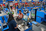 The first customer at the Westerville Walmart buys bubble gum for herself.
