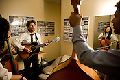 "Scott Avett practices a song from the Avett Brothers' upcoming EP ""The Second Gleam""  with Joe Kwon, reflected in mirror, and Bob Crawford, backstage at the Birchmere in Alexandria, VA, Friday, June 20, 2008."