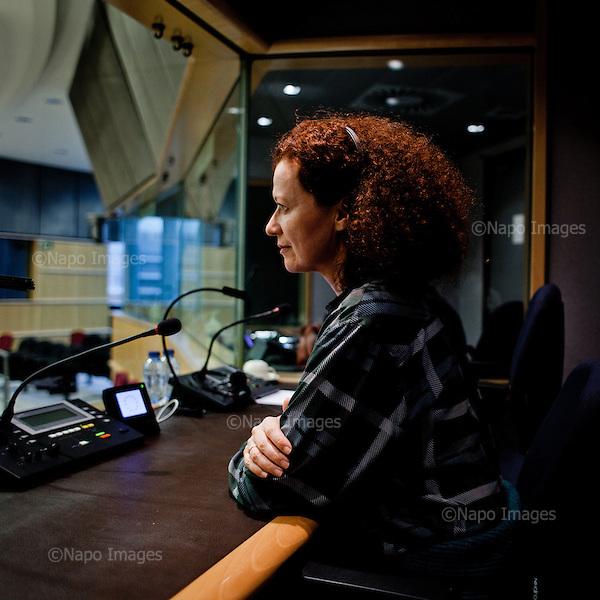 BRUSSELS, BELGIUM, DECEMBER 1, 2014:  Translator Susan Altenberg poses at the translator booth of European Parliament in Brussels. Every month she, with thousands of other parliament's staff travels  back and forth between  Brussels and Strasbourg. (Photo by Piotr Malecki / Napo Images)  <br /> BRUKSELA, BELGIA, 01/12/2014: Tlumaczka Susan Altenberg pozuje w pomieszczeniu dla tlumaczy w Parlamencie Europejskim w Brukseli. Kazdego miesiaca ona oraz tysiace innych pracownikow parlamentu podrozuja miedzy siedzibami w Brukseli i Strasburgu. Fot: Piotr Malecki / Napo Images