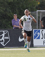 Portland Thorns FC forward Alex Morgan (13) brings the ball forward.  In a National Women's Soccer League (NWSL) match, Portland Thorns FC (white/black) defeated Boston Breakers (blue), 2-1, at Dilboy Stadium on July 21, 2013.