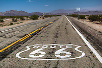 Route 66 shield painted on the road, Chambless California.