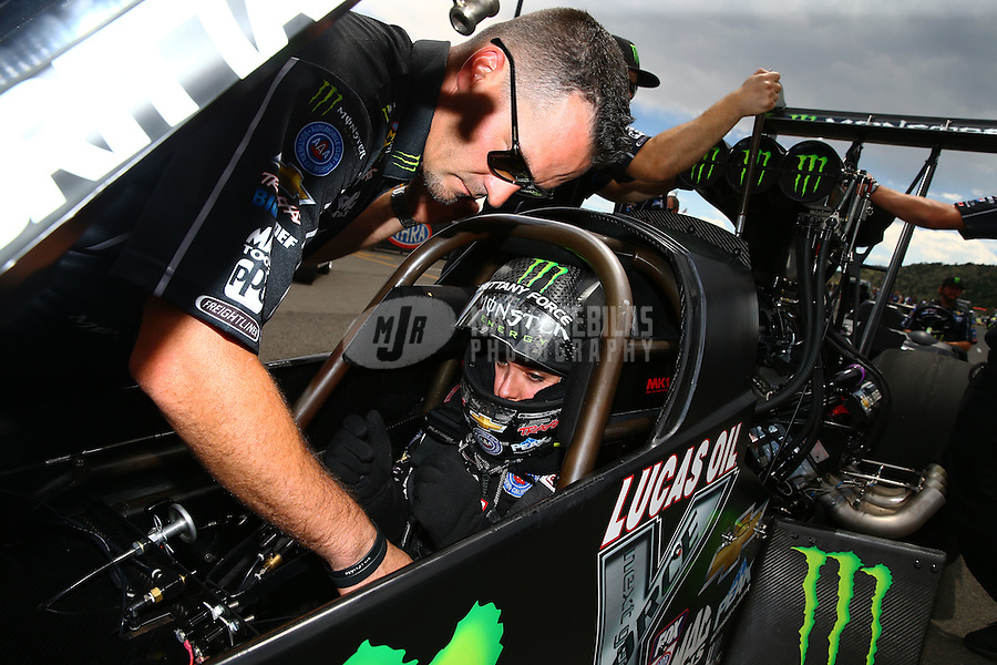 Jul 24, 2016; Morrison, CO, USA; Crew member with NHRA top fuel driver Brittany Force during the Mile High Nationals at Bandimere Speedway. Mandatory Credit: Mark J. Rebilas-USA TODAY Sports