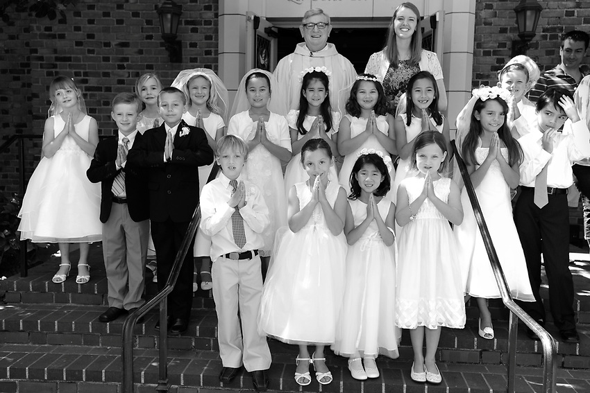 The 2013 Children's Faith Formation class celebrated their First Communion at Holy Spirit Catholic Church with Father Daniel Looney, Saturday, May 18, 2012 in Sacramento, California's Land Park neighborhood. (photo by Pico van Houtryve)