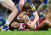 Picture by Allan McKenzie/SWpix.com - 13/04/2018 - Rugby League - Betfred Super League - Leeds Rhinos v Wigan Warriors - Headingley Carnegie Stadium, Leeds, England - WIgan's Willie Isa is floored by Leeds's Adam Cuthbertson.