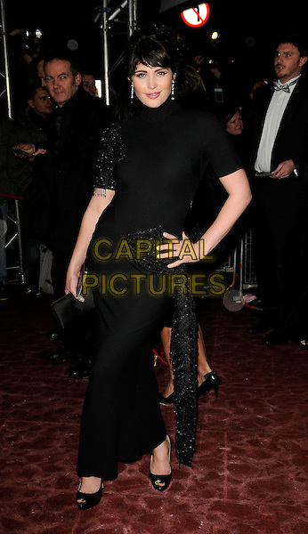 GEMMA ARTERTON.The Orange British Academy Film Awards 2009 Soho House Grey Goose After Party at the Grosvenor House Hotel, London, England. .February 8th, 2009 .bafta baftas full length black polo neck dress beaded beads peep toe shoes long maxi hand on hip.CAP/CAN.©Can Nguyen/Capital Pictures.