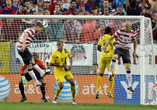 08.06.2012. Tampa, Florida, USA.  Clarence Goodson (21) of USA MNT heads over Marc Joseph (5) of Antigua & Barbuda during a 2014 FIFA World Cup qualifying match at Raymond James Stadium in Tampa, Florida. USA won 3-1.