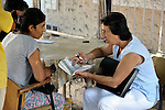 Ljatife Sikovska (right) is director of Ambrela, a grassroots Roma women's organization in Suto Orizari, the Macedonian municipality that is Europe's largest Roma settlement. Here she talks with a woman on a street in Suto Orizari about the woman's lack of sufficient legal documents, a common headache for Roma in Macedonia.