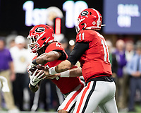 ATLANTA, GA - DECEMBER 7: Jake Fromm #11 of the Georgia Bulldogs hands the ball off to James Cook #4 during a game between Georgia Bulldogs and LSU Tigers at Mercedes Benz Stadium on December 7, 2019 in Atlanta, Georgia.