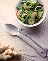 top shot of Bean & apple salad in a white bowl with French salad spoons