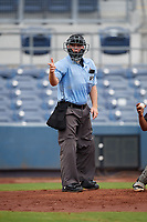 Umpire Brandon Blome calls a strike during a Florida State League game between the Bradenton Maruaders and Charlotte Stone Crabs on August 7, 2019 at Charlotte Sports Park in Port Charlotte, Florida.  Charlotte defeated Bradenton 3-2 in the second game of a doubleheader.  (Mike Janes/Four Seam Images)