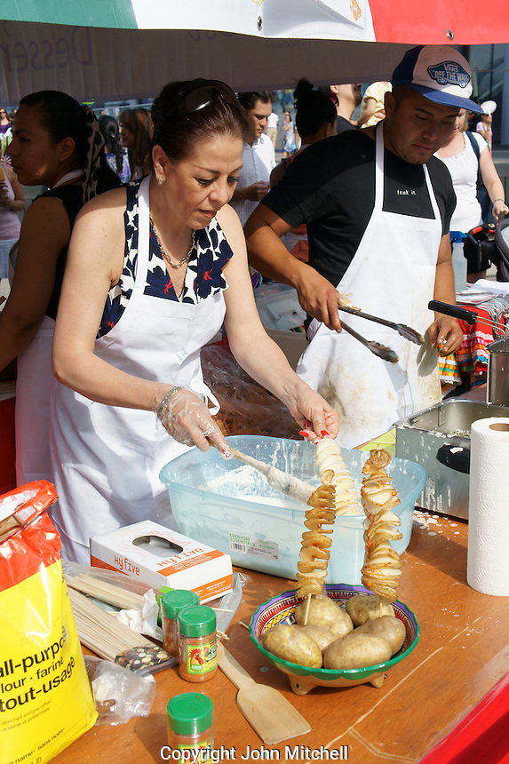 Mexican woman making espiro papas or twisted potatoes at the Mexico Fest 2012 celebrations on Sept. 8, 2012 in Vancouver, British Columbia, Canada. These celebrations commemorated 202 years of Mexican Independence.
