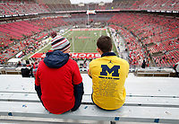 Brothers Stephen Fedak, 23, a 2018 University of Michigan grad, and Andrew Fedak, 20, a sophomore at Ohio State, both of Livonia, Mich. take their seats in the south stands prior to the NCAA football game between the two schools at Ohio Stadium in Columbus on Nov. 24, 2018. [Adam Cairns/Dispatch]