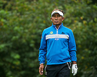 14.10.2014. The London Golf Club, Ash, England. The Volvo World Match Play Golf Championship.  Thongchai Jaidee [THI] on the par three eighth hole during the Pro-Am event.