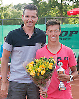 August 9, 2014, Netherlands, Rotterdam, TV Victoria, Tennis, National Junior Championships, NJK,  Prize giving, Richard Krajicek with Ruben Konings , runner up boys 16 years<br /> Photo: Tennisimages/Henk Koster