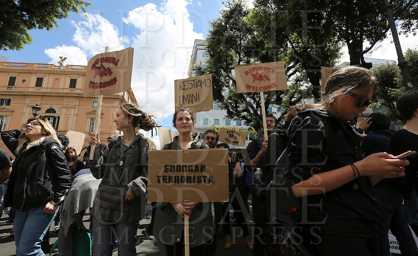 """Manifestazione contro gli accordi tra Unione Europea e Turchia sui migranti, a Roma, 1 maggio 2016.<br /> Activists make their way to the Turkish embassy during a protest against the agreement between the EU and Turkey on migrants in Rome, 1 May 2016. The sign at center reads """"Erdogan terrorist"""".<br /> UPDATE IMAGES PRESS/Riccardo De Luca"""