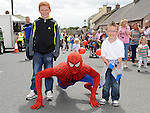Sean and Cian White pictured with Spiderman at the Clogherhead 10k run. Photo: Colin Bell/pressphotos.ie