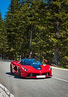 Deutschland, Bayern, Berchtesgadener Land, oberhalb Berchtesgaden: mit einem roten Ferrari unterwegs auf der Rossfeld-Ringstrasse   Germany, Upper Bavaria, Berchtesgadener Land, above Berchtesgaden: with a red Ferrari driving the Rossfeld-Ringstrasse