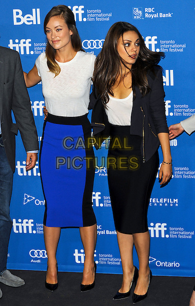 Olivia Wilde and Mila Kunis<br /> &quot;Third Person&quot; Press Conference  - 2013 Toronto International Film Festival held at TIFF Bell Lightbox, Toronto, Ontario, Canada.<br /> September 10th, 2013<br /> full length white top blue skirt black jacket    <br /> CAP/ADM/BPC<br /> &copy;Brent Perniac/AdMedia/Capital Pictures