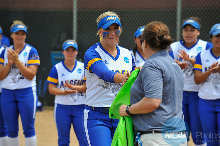 SALEM, VA - MAY 29:  Kenedy Urbany (20) of Angelo State University receives her award during the Division II Women's Softball Championship held at Moyer Park on May 29, 2017 in Salem, Virginia. Minnesota State defeated Angelo State 5-1 to win the national championship. (Photo by Andres Alonso/NCAA Photos via Getty Images)