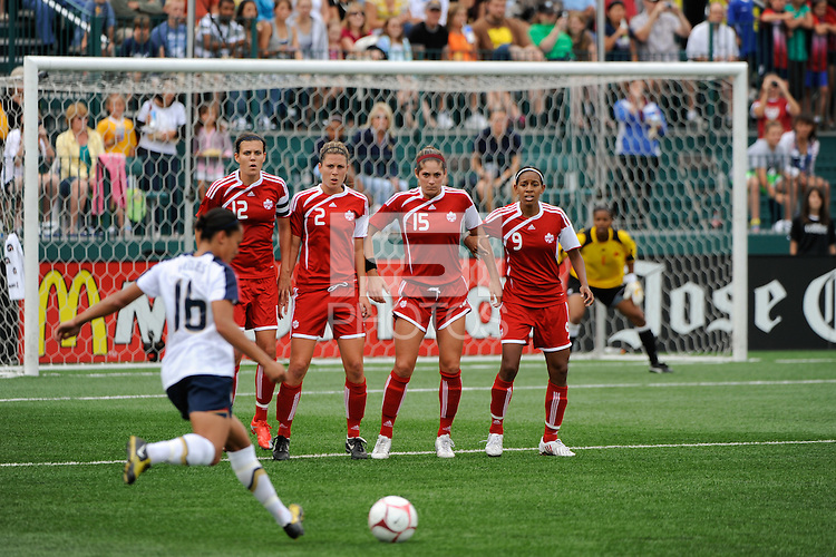 Christine Sinclair (12), Emily Zurrer (2), Kara Lang (15), and Candace Chapman (9) form a wall as Angela Hucles (16) of the United States (USA) takes a free kick. The United States (USA) Women's National Team defeated Canada (CAN) 1-0 during an international friendly at Marina Auto Stadium in Rochester, NY, on July 19, 2009.