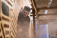 Mount Athos - The Holy Mountain.<br /> A monk makes a window frame.<br /> <br /> Photographer: Rick Findler