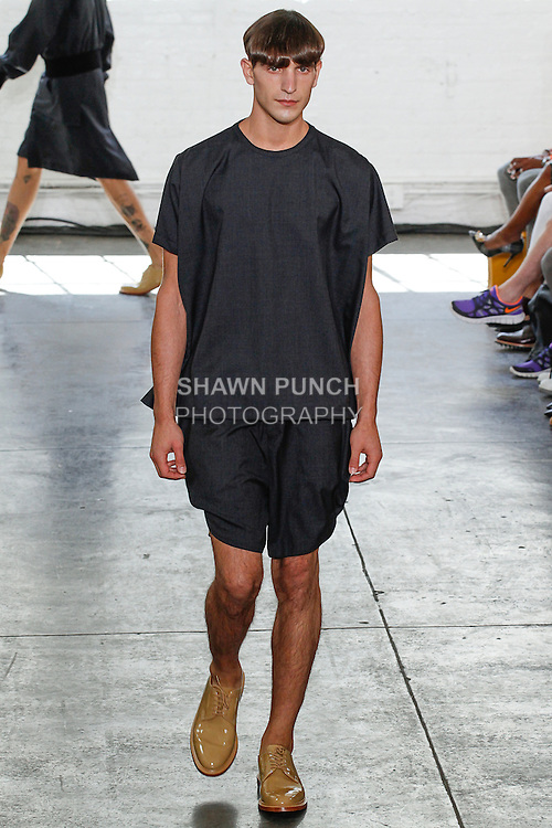 Model walks runway in an outfit from the Duckie Brown Spring Summer 2014 My Duckie collection, by Steven Cox and Daniel Silver, during New York Fashion Week Spring 2014, on September 6, 2013.