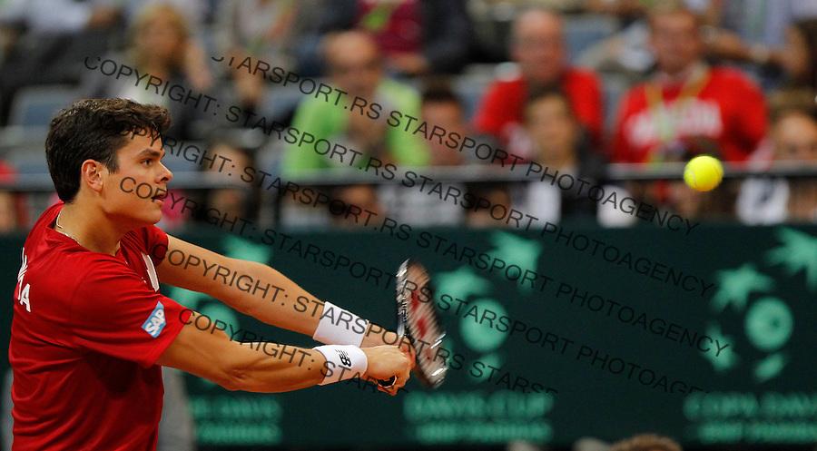 Tennis Tenis<br /> Davis Cup semifinal polufinale<br /> Serbia v Canada<br /> Janko Tipsarevic v Milos Raonic<br /> Milos Raonic returns the ball<br /> Beograd, 13.09.2013.<br /> foto: Srdjan Stevanovic/Starsportphoto &copy;