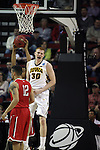 Iowa's Aaron White (30) celebrates after dunking the ball against Davidson during the 2015 NCAA Division I Men's Basketball Championship's March 20, 2015 at the Key Arena in Seattle, Washington.  Iowa beat Davidson 83-52.        ©2015. Jim Bryant Photo. ALL RIGHTS RESERVED.