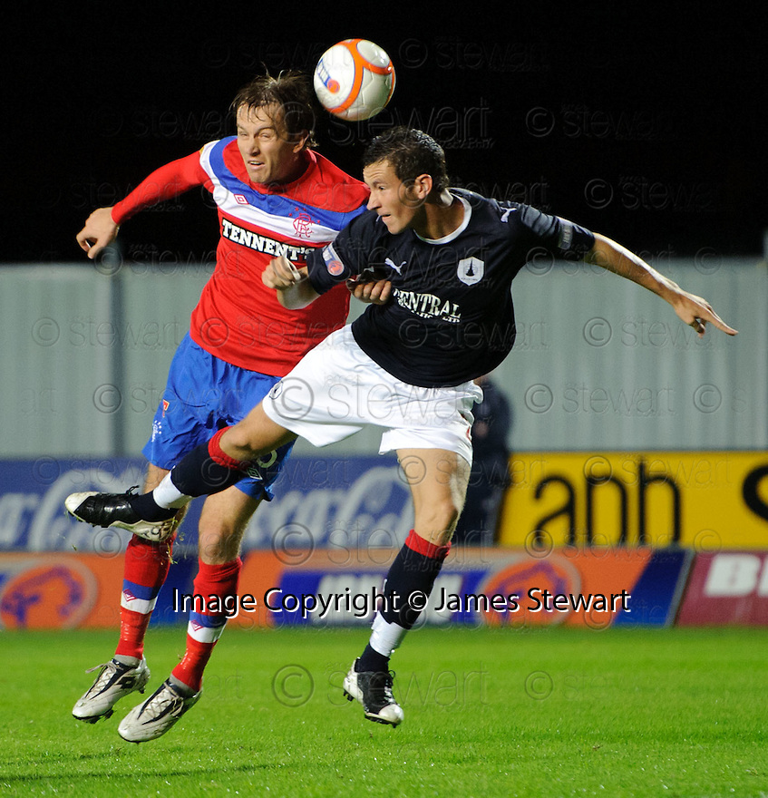 RANGERS' SASA PAPAC AND FALKIRK'S KIERAN DUFFIE GO FOR THE HIGH BALL