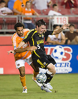 Columbus Crew midfielder Danny O'Rourke (5) shields the ball from Houston Dynamo midfielder Dwayne De Rosario (14). The Houston Dynamo tied the Columbus Crew 1-1 in a regular season MLS match at Robertson Stadium in Houston, TX on August 25, 2007.
