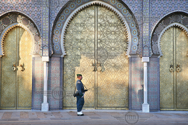 A guard in front of the Royal Palace or Dar el-Makhzen with its impressive bronze doors in Moorish style.  This used to be the residence of the sultan and is now used by the king when he is in Fez.