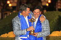 Winning captain Jose Maria Olazabal and Lee Westwood with the Ryder Cup at the end of Sunday's singles matches at the Ryder Cup 2012, Medinah Country Club,Medinah, Illinois,USA 30/09/2012.Picture: Fran Caffrey/www.golffile.ie.