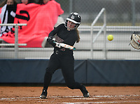 NWA Democrat-Gazette/CHARLIE KAIJO Springdale High School Madeleine Downing (10) hits during a softball game, Thursday, March 13, 2019 at Bentonville West High School in Centerton.