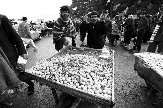 A man sells lemons in the central market of Kabul, Afghanistan. Despite the ever-present mud and miserable winter weather, the market bustles daily with commerce of all kinds. Taliban attacks in the Afghan capital have so far been infrequent, and as life goes on at a normal pace, the war often seems far away. Feb. 3, 2009.