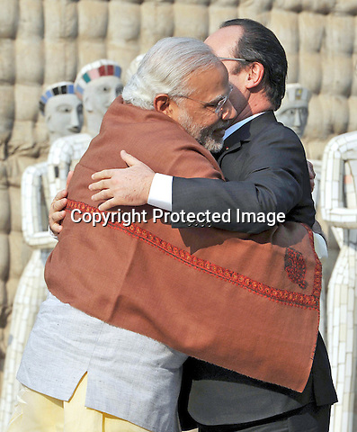 24.01.2016; Chandigarh, India: INDIAN PM MODI HUGS PRESIDENT HOLLANDE OF FRANCE<br /> on his visit to the Nek Chand Rock Garden, in Chandigarh.<br /> The French President in the guest of honour for the Republic Day celebrations on the 26th of January 2016.<br /> Mandatory Credit Photos: &copy;NEWSPIX INTERNATIONAL<br /> <br /> PHOTO CREDIT MANDATORY!!: NEWSPIX INTERNATIONAL(Failure to credit will incur a surcharge of 100% of reproduction fees)<br /> <br /> IMMEDIATE CONFIRMATION OF USAGE REQUIRED:<br /> Newspix International, 31 Chinnery Hill, Bishop's Stortford, ENGLAND CM23 3PS<br /> Tel:+441279 324672  ; Fax: +441279656877<br /> &quot;All fees payable to &quot;Newspix International&quot;<br /> e-mail: info@newspixinternational.co.uk