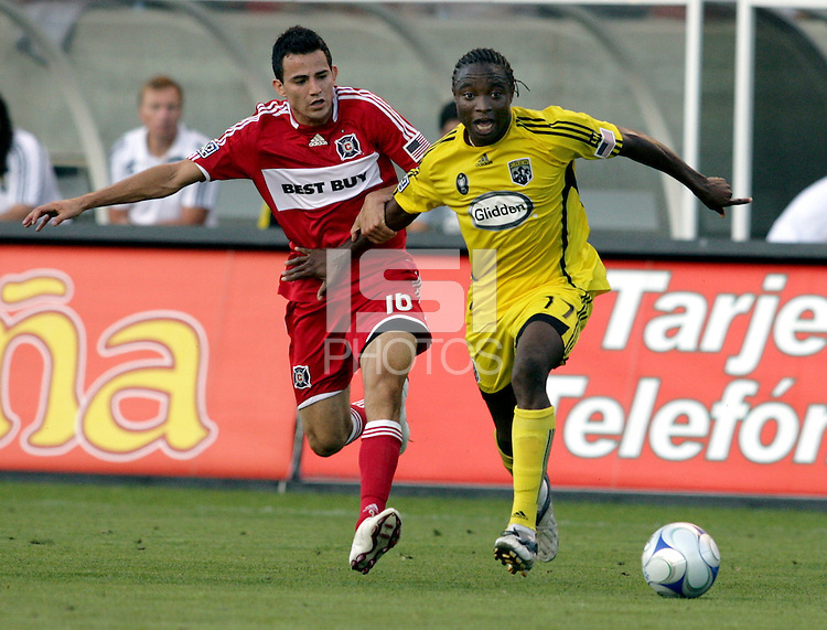 Columbus Crew midfielder Emmanuel Ekpo (17) is pressured by Chicago Fire midfielder Marco Pappa (16).  The Chicago Fire tied the Columbus Crew 0-0 at Toyota Park in Bridgeview, IL on July 11, 2009.