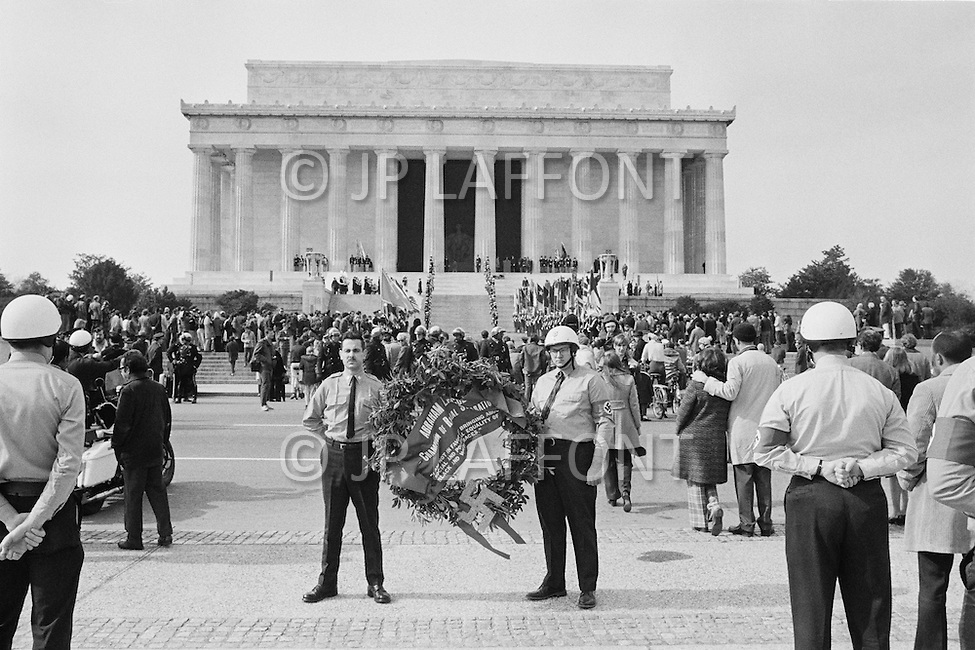 12 Feb 1972, Washington, DC, USA --- On Abraham Lincoln's birthday, the Commander of the National Socialist White People's Party, Matt Koehl, and his troops pay tribute by laying flowers at the Lincoln Memorial. The police are in attendance watching the ceremony. --- Image by © JP Laffont