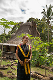 INDONESIA, Flores, Ngada district, Reny Ngadha in front of her home  at  Belaraghi Village