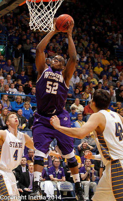 SIOUX FALLS, SD - MARCH 9:  Michael Ochereobia #52 from Western Illinois pulls down a rebound in front of Jake Bittle #4 and Jordan Dykstra #42 from South Dakota State University in the second half of their quarterfinal game at the 2014 Summit League Tournament Sunday evening in Sioux Falls, SD. (Photo by Dave Eggen/Inertia)
