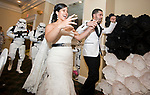 WATERBURY, CT-081217JS06-- Bride and groom, Francheska Lopez Morgado and Alexander Morgado, are escorted into their reception by Storm Troopers during their Star Wars themed wedding Saturday at the community room at Holy Trinity Church in Waterbury. <br />  Jim Shannon Republican-American