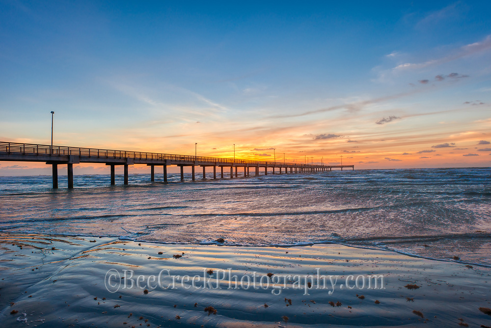 This is photo taken as the sunrises just over the horizon behind the fishing pier in Port Aransas Texas, a favorite spot for fishermen and beach goers to hangout.