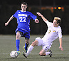 Ryan Hilke #22 of Calhoun, left, gets oressured by Ryan McMahon #7 of Massapequa during the Nassau County varsity boys soccer Class AA final at Hofstra University on Wednesday, Nov. 2, 2016. Hilke scored the game-winning goal in the first minute of overtime to lift the Colts to a 1-0 victory.