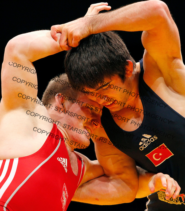 BELGRADE, SERBIA - MARCH 06: Yakup Gor of Turkey (R), fights against Adam Konrad Gor of Poland (L), in the Men's Freestyle 66kg during the European wrestling championship March 06, 2011 in Belgrade, Serbia.(Photo by Srdjan Stevanovic/Getty Images)
