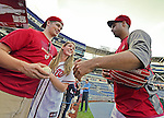 21 September 2012: Washington Nationals pitcher Gio Gonzalez gives autographs and chats with fans prior to a game against the Milwaukee Brewers at Nationals Park in Washington, DC. The Nationals fell to the Brewers 4-2 in the first game of their 4-game series. Mandatory Credit: Ed Wolfstein Photo