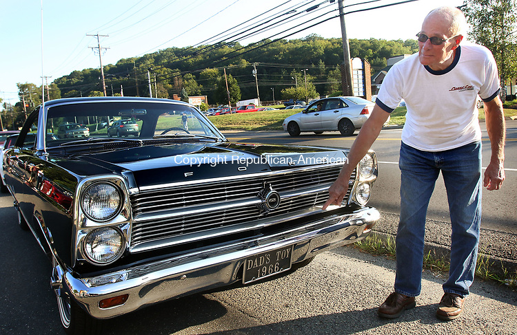 OXFORD CT. 16 August 2017-081617SV01-Bruce Martin of Waterbury shows off his 1966 Ford Fairlane at Fritz&rsquo;s Snack Bar in Oxford Wednesday. Fritz&rsquo;s has a cruise night every Wednesday 5-9 in the summer.<br /> Steven Valenti Republican-American