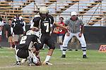Palos Verdes, CA 09/30/11 -Ian Escutia (Peninsula #2) and Tony Bumatay (Peninsula #7) in action during the Lawndale-Peninsula Varsity football game.